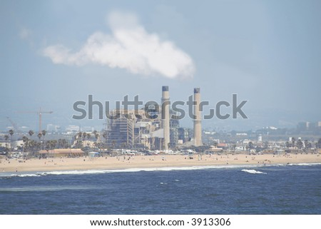 oil refinery off a beach - stock photo