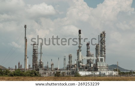 Oil refinery on blue sky background.