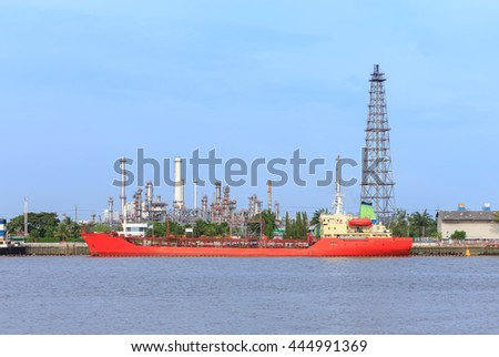 Oil refinery on water front and oil tanker