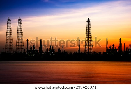 Oil refinery or petrochemical industry at before sunrise in thailand. It is beautiful in siluette tone. - stock photo
