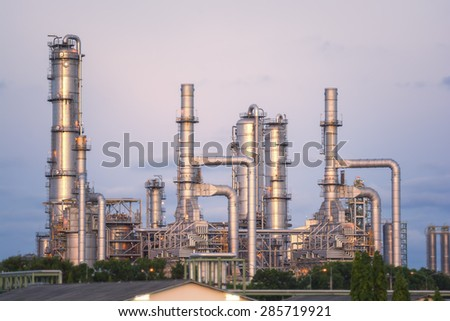 Oil refinery or petrochemical industry at twilight sky - stock photo