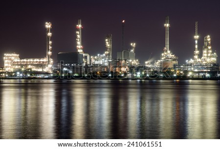 Oil refinery or petrochemical industry  in thailand.at dark for Logistic Import Export background - stock photo