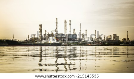 Oil refinery or petrochemical industry in thailand. edit flare effect and warm tone.