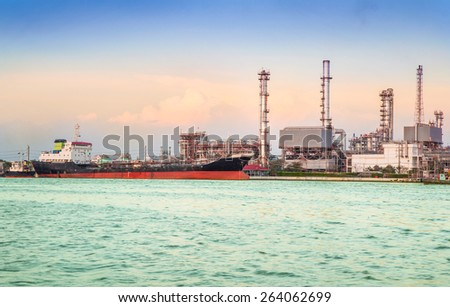 Oil refinery or petrochemical industry with ship in thailand. for Logistic Import Export background,Chao Phraya river, Thailand - stock photo