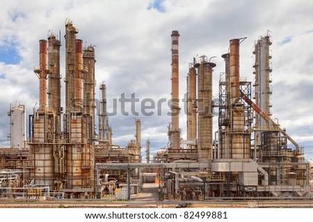 oil refinery petrochemical  chemical industry fuel distillation of petrol petrochemy industrial pipelines and chimney. Power plant. Oil industry - stock photo