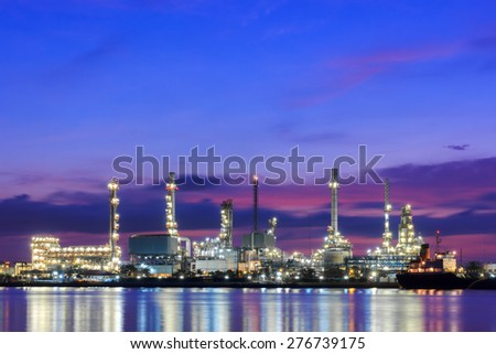 Oil refinery petrochemical industrial plant at twilight - stock photo