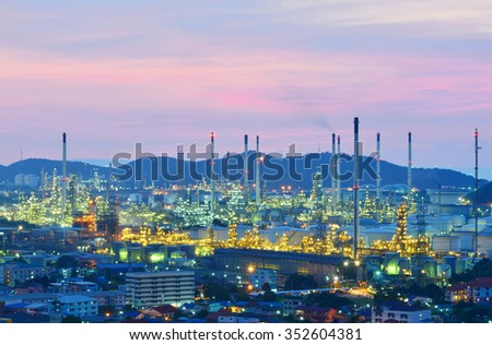 Oil refinery , Petrochemical industrial with city background at sunset , Si Racha District, Chon Buri , Thailand - stock photo