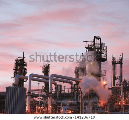 Oil refinery piping and towers - stock photo