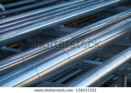 Oil refinery piping system - stock photo