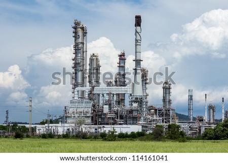 oil refinery plant against blue sky - stock photo
