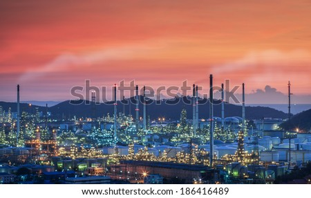 oil refinery plant along the twilight from sunset - stock photo