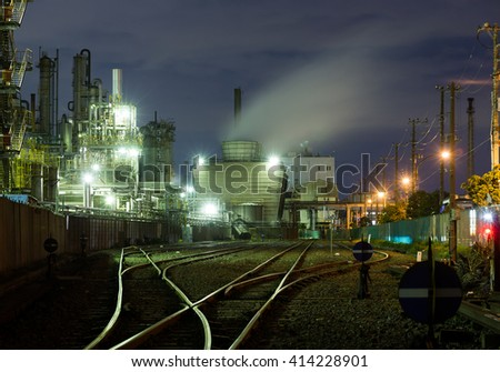 Oil-refinery plant at night - stock photo
