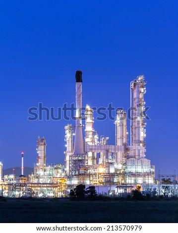 Oil refinery plant at twilight dark blue sk - stock photo