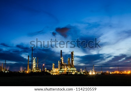 Oil refinery plant at twilight dark blue sky. - stock photo