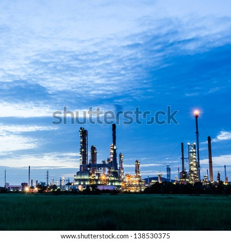 Oil refinery plant at twilight dark blue sky. - stock photo