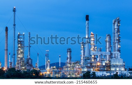 Oil refinery plant at twilight dark blue sky - stock photo