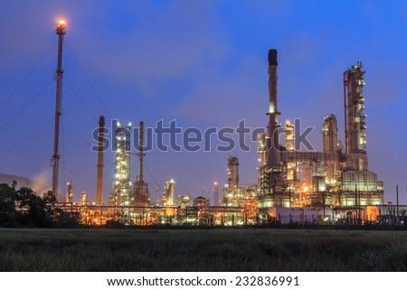 Oil refinery plant at twilight dark blue sky - stock photo