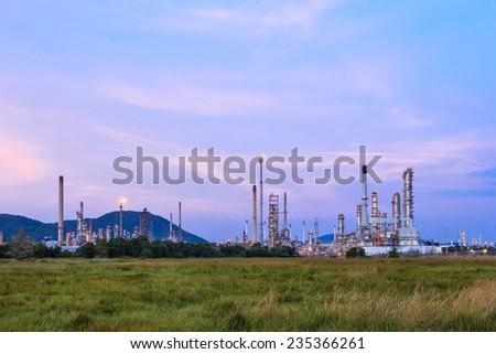 Oil refinery plant at twilight night - stock photo
