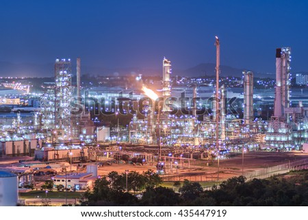 Oil refinery plant at twilight with sky background, Oil refinery industry, Industry Petrochemical plant in sunshine, overall view of an oil and gas refinery, pipelines and towers, heavy industry - stock photo