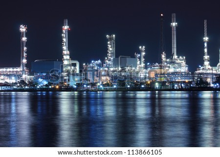 Oil refinery plant night scene nearby river in Thailand - stock photo