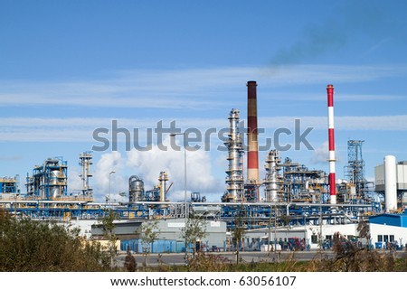 Oil refinery plant over blue sky. - stock photo