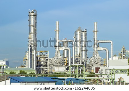 Oil refinery plant with blue sky background. - stock photo