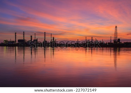 Oil refinery silhouette along the river at sunrise time (Bangkok, Thailand) - stock photo