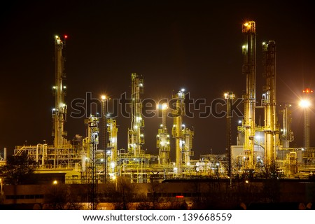 Oil refinery structures at night