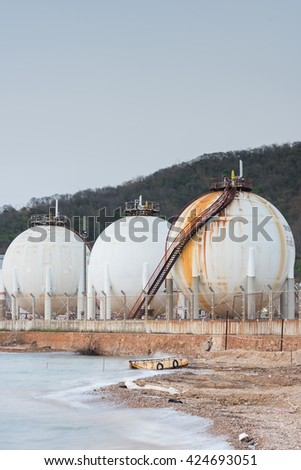 Oil refinery tanks petroleum plant with blue sky - stock photo
