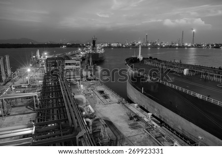Oil ,refinery water reflection twilight sunset black and white tone. - stock photo