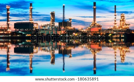 Oil refinery with reflection at twilight Bangkok Thailand  - stock photo