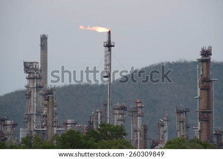 Oil refinery with the cloudy sky  - stock photo