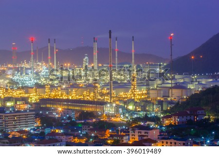 Oil refinery with tube and oil tank along night sky at Si Racha District, Rayong Province, Thailand - stock photo