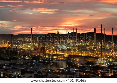 Oil refinery with tube and oil tank at sunset - stock photo