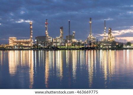 Oil refinery with water reflection at night.