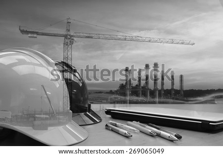 Oil refinery work Safety first  wearing a Safety helmet  black and white tone. - stock photo