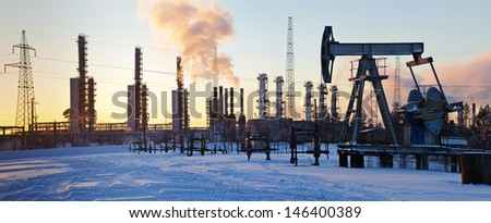 Oil rig and grangemouth refinery on the sunset sky background. Panorama. - stock photo