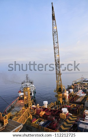 Oil Rig and Ship - stock photo