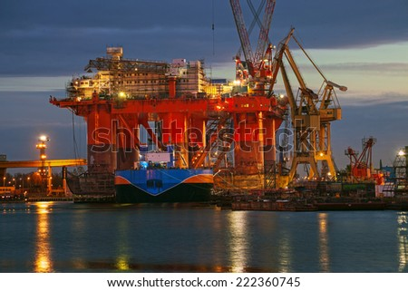 Oil rig at dawn in the shipyard of Gdansk, Poland. - stock photo