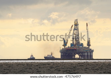 Oil Rig At Dusk - stock photo