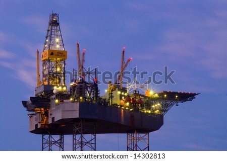 Oil Rig at evening - stock photo