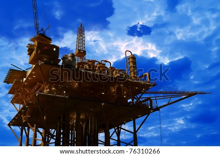 Oil Rig at late evening - stock photo