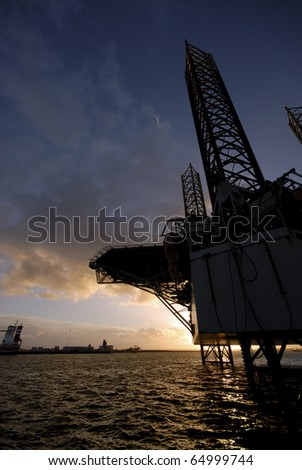 Oil rig close to Esbjerg harbour in Denmark. - stock photo