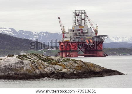 Oil rig in norwegian fjord  landscape - stock photo