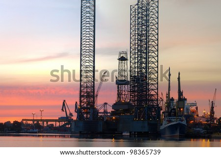 Oil Rig in the morning at the shipyard. - stock photo