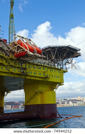 oil rig on harbour for make reparations - stock photo