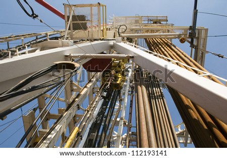 Oil Rig Pipes and Tower - stock photo