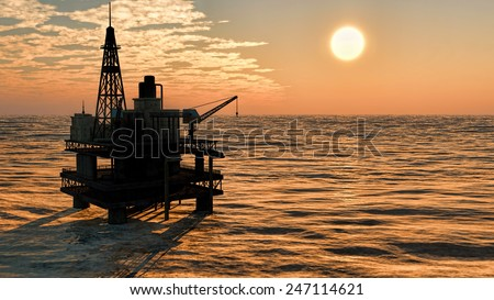 Oil rig  platform at sunset - stock photo