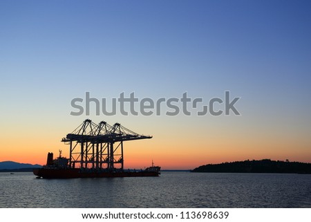 Oil rig ship in the ocean during sunset - stock photo