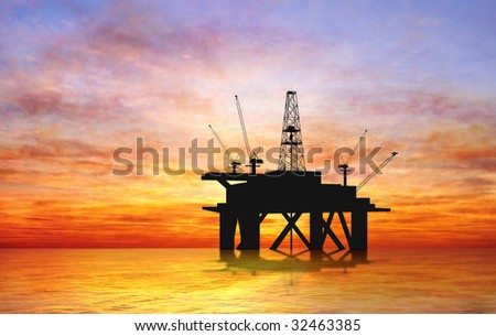 Oil rig silhouette over orange sky - stock photo